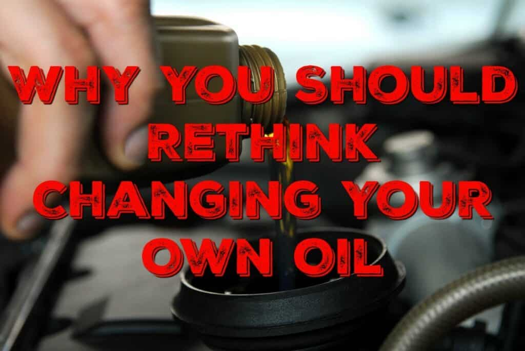 """Close-up of a hand pouring new engine oil into a vehicle's tank, captioned """"Why you should rethink changing your own oil"""""""